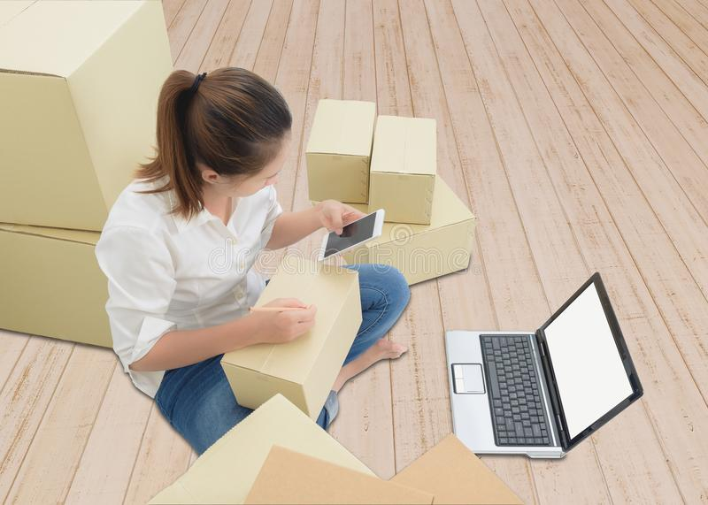 Teenager owner business woman work at home with smartphone, laptop for online shopping writing the order. Teenager owner business woman work at home or office stock photos