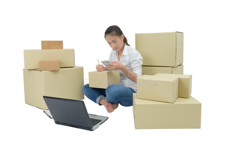Teenager owner business woman work at home with smartphone, laptop for online shopping writing the order. Isolated on white background with clipping path royalty free stock image