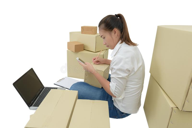 Teenager owner business woman work at home with smartphone, laptop for online shopping writing the order. Isolated on white background with clipping path stock photography
