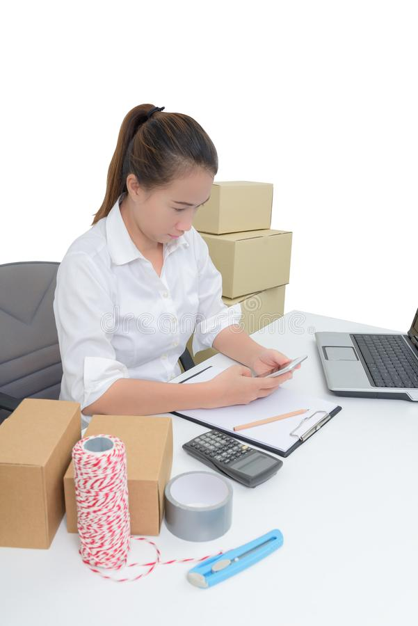 Teenager owner business woman work at home with smartphone, laptop for online shopping writing the order. On white background with clipping path stock images