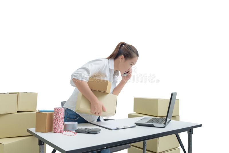 Teenager owner business woman work at home with smartphone, laptop for online shopping writing the order. On white background with clipping path royalty free stock image