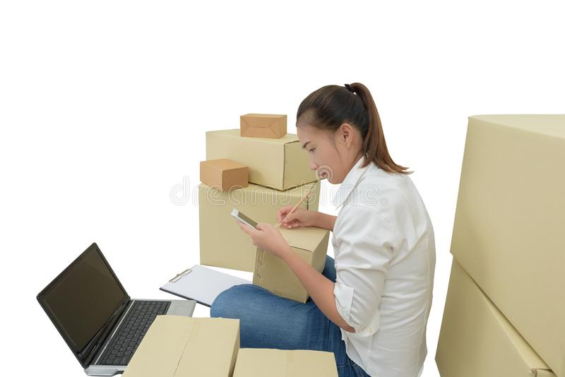 Teenager owner business woman work at home with smartphone, laptop for online shopping writing the order. On white background with clipping path royalty free stock images