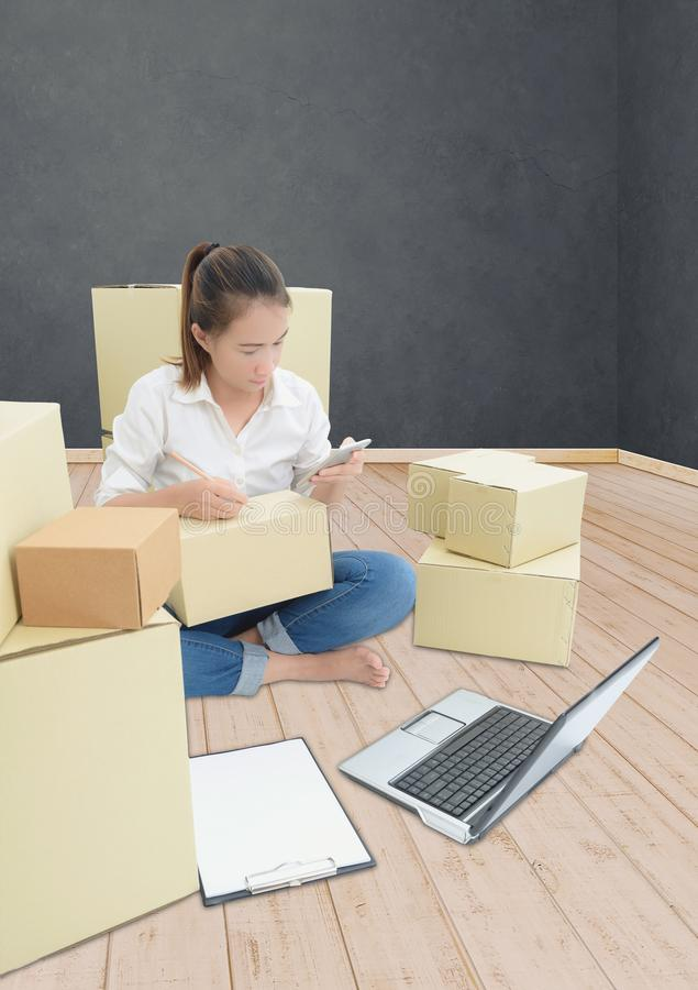 Teenager owner business woman work at home with smartphone, laptop for online shopping writing the order. Teenager owner business woman work at home or office royalty free stock photo