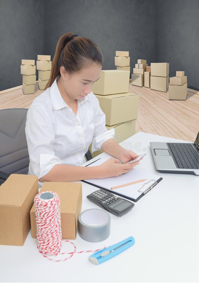 Teenager owner business woman work at home with smartphone, laptop for online shopping writing the order. Teenager owner business woman work at home or office royalty free stock photos