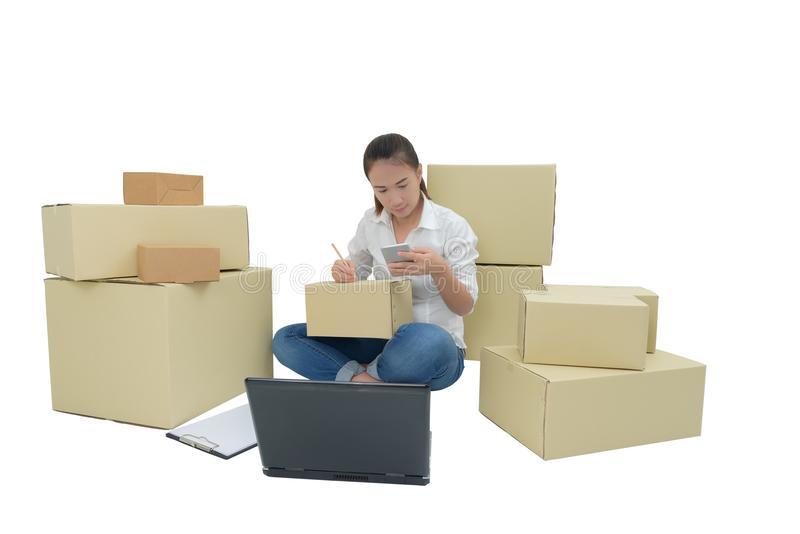 Teenager owner business woman work at home with smartphone, laptop for online shopping writing the order. Isolated on white background with clipping path royalty free stock photo