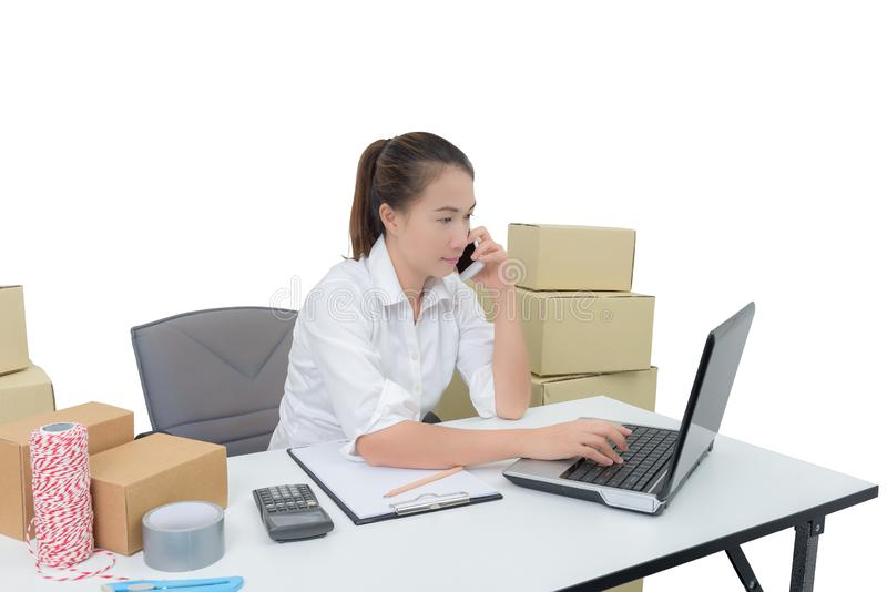 Teenager owner business woman work at home with smartphone, laptop for online shopping writing the order. Isolated on white background with clipping path stock photo