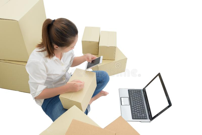 Teenager owner business woman work at home with smartphone, laptop for online shopping writing the order. Isolated on white background with clipping path royalty free stock images