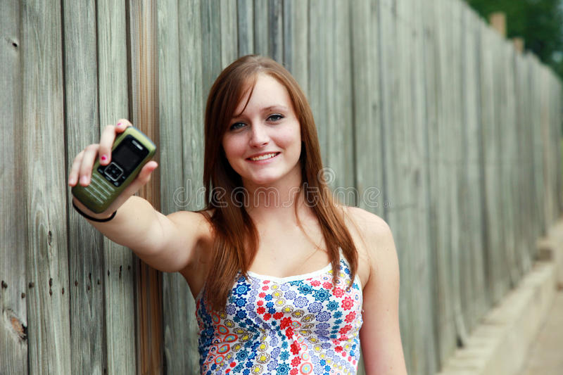 Teenager With Phone Royalty Free Stock Photo