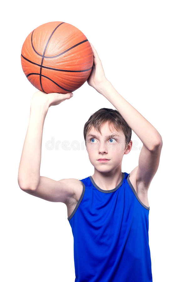 Teenager playing with a basketball. Isolated on white background. Teenager in a blue t-shirt playing with a basketball. Isolated on white background royalty free stock images