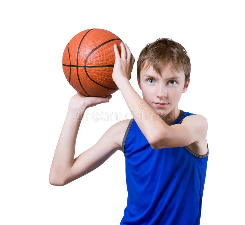 Teenager playing with a basketball. Isolated on white background. Teenager in a blue t-shirt playing with a basketball. Isolated on white background royalty free stock photos