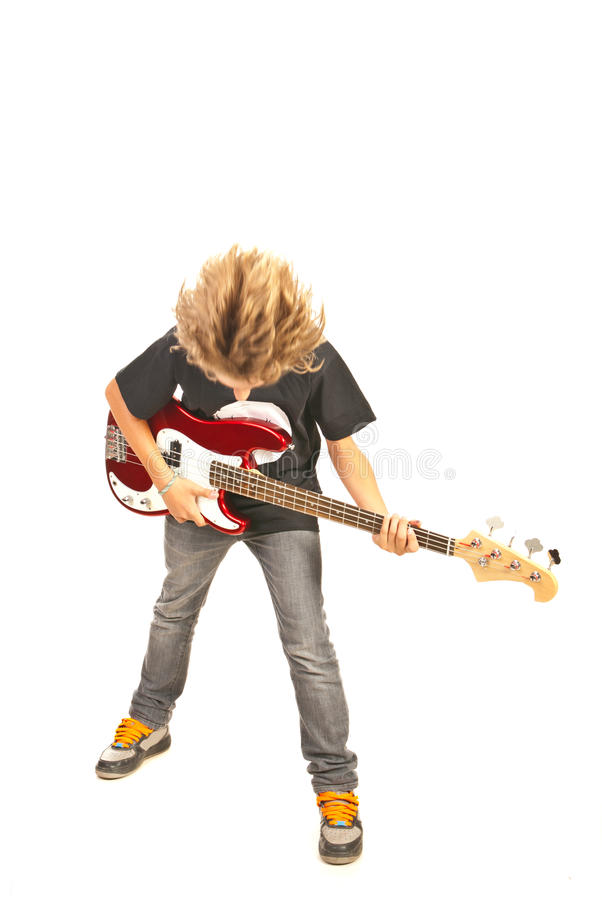 Teenager playing bass guitar stock photo
