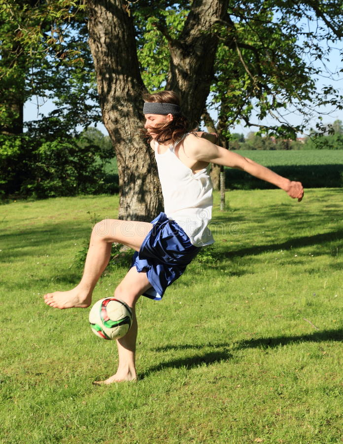 Teenager playing football stock photos