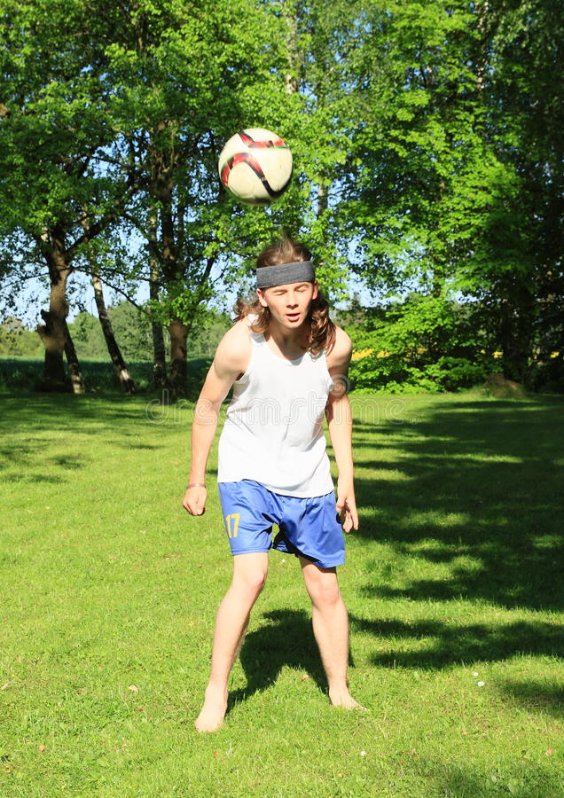 Teenager playing football - header royalty free stock images