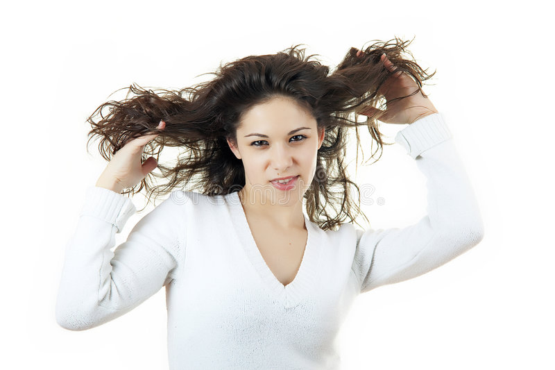 Teenager playing with hair royalty free stock photo