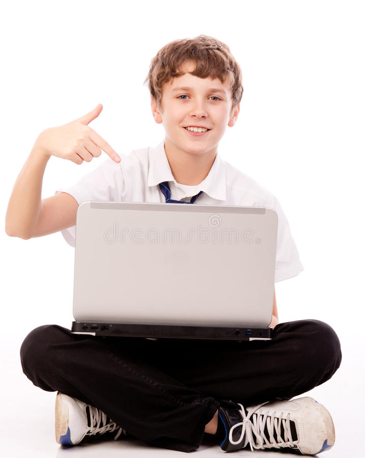 Download Teenager Pointing To The Laptop Stock Image - Image: 28273841