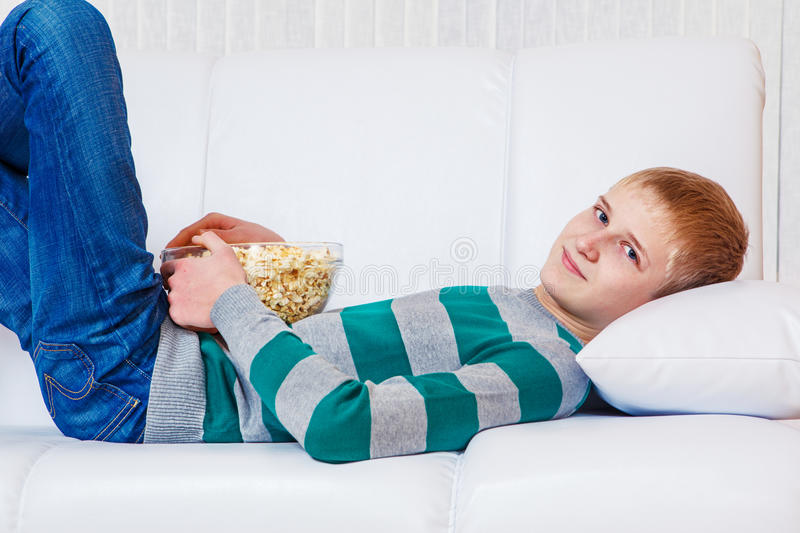 Teenager with popcorn royalty free stock images