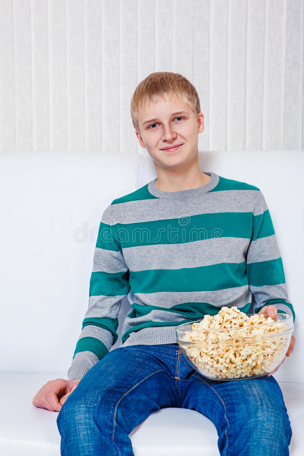 Teenager with popcorn stock photography