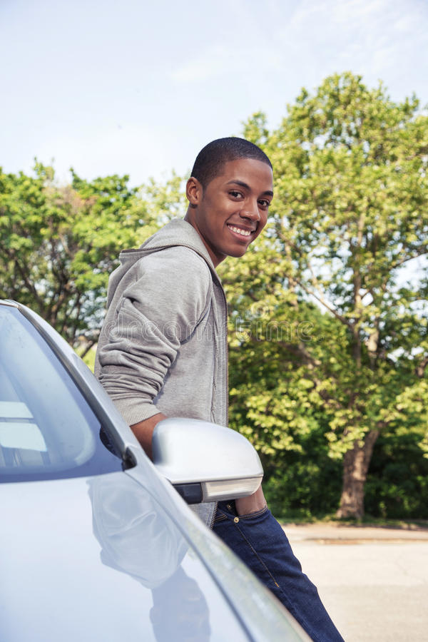 Teenager portrait with new car royalty free stock image