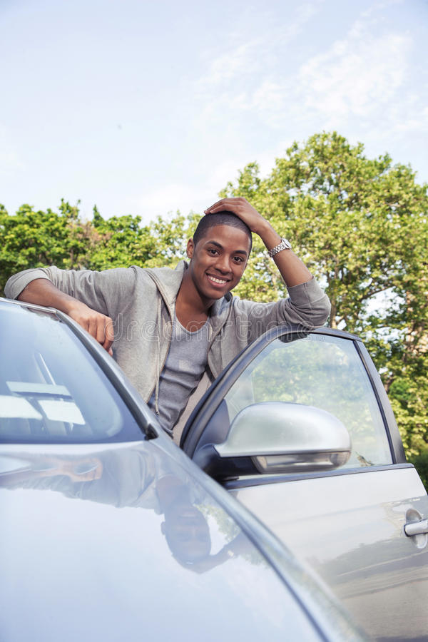 Teenager portrait with new car royalty free stock images