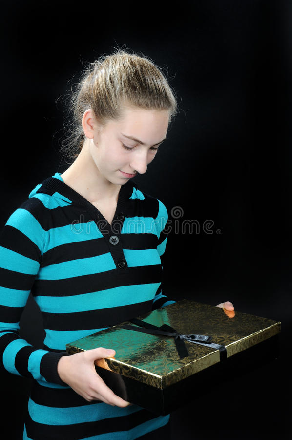 Teenager with present stock photos