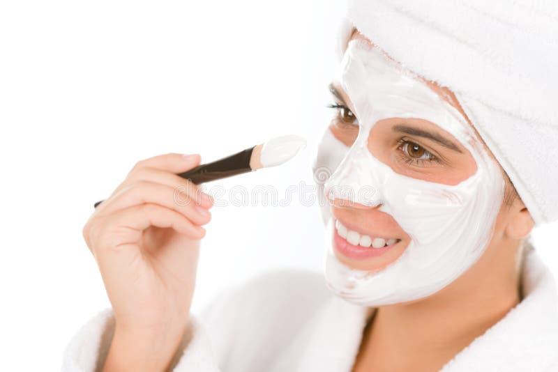 Teenager problem skin care - woman facial mask stock photos