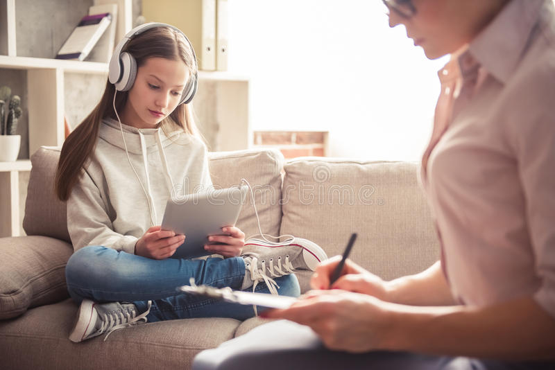Teenager at the psychotherapist stock image