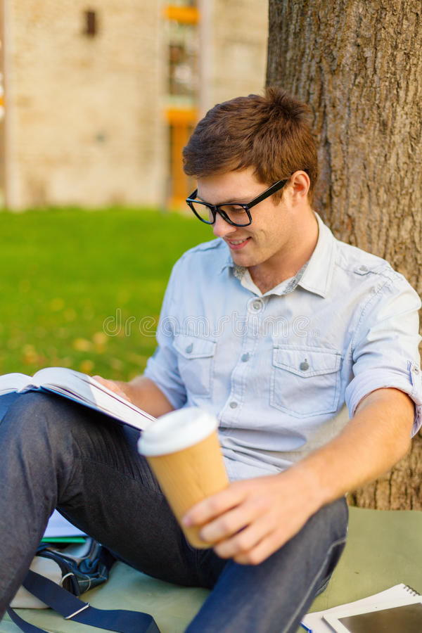 Download Teenager Reading Book With Take Away Coffee Stock Image - Image: 37173841