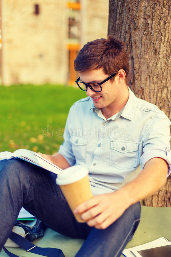 Download Teenager Reading Book With Take Away Coffee Stock Image - Image of preparation, campus: 41313075