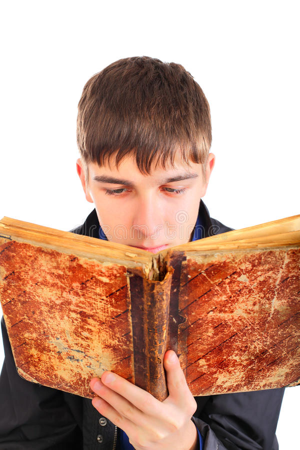 Download Teenager reads old book stock image. Image of isolated - 12606583