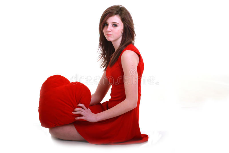 Teenager with red heart royalty free stock photo