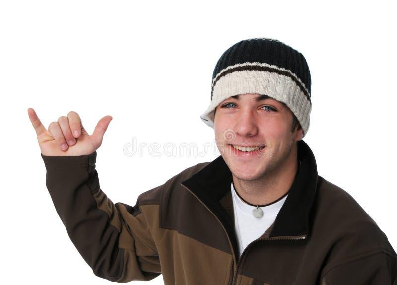 Teenager rendendo ad una mano segno allentato immagini stock