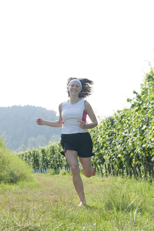 Teenager running in country royalty free stock photos