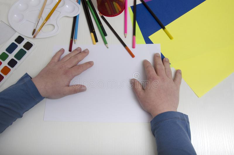 Teenager`s hands with syndrome down.Education concept for people with syndrome down royalty free stock photos