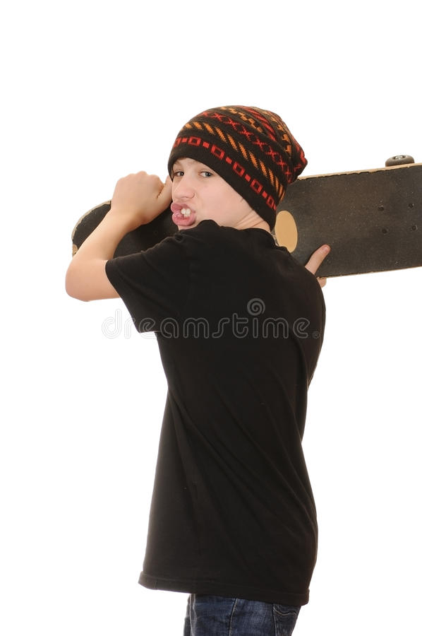 The teenager with a skateboard. And in a hat isolated on white background stock photos