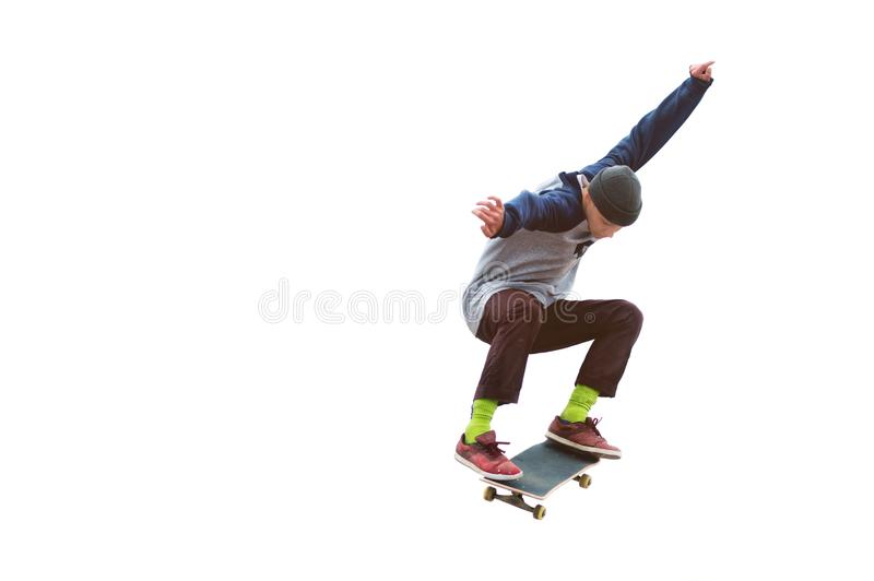 A teenager skateboarder jumps an ollie on an isolated white background. The concept of street sports and urban culture royalty free stock images