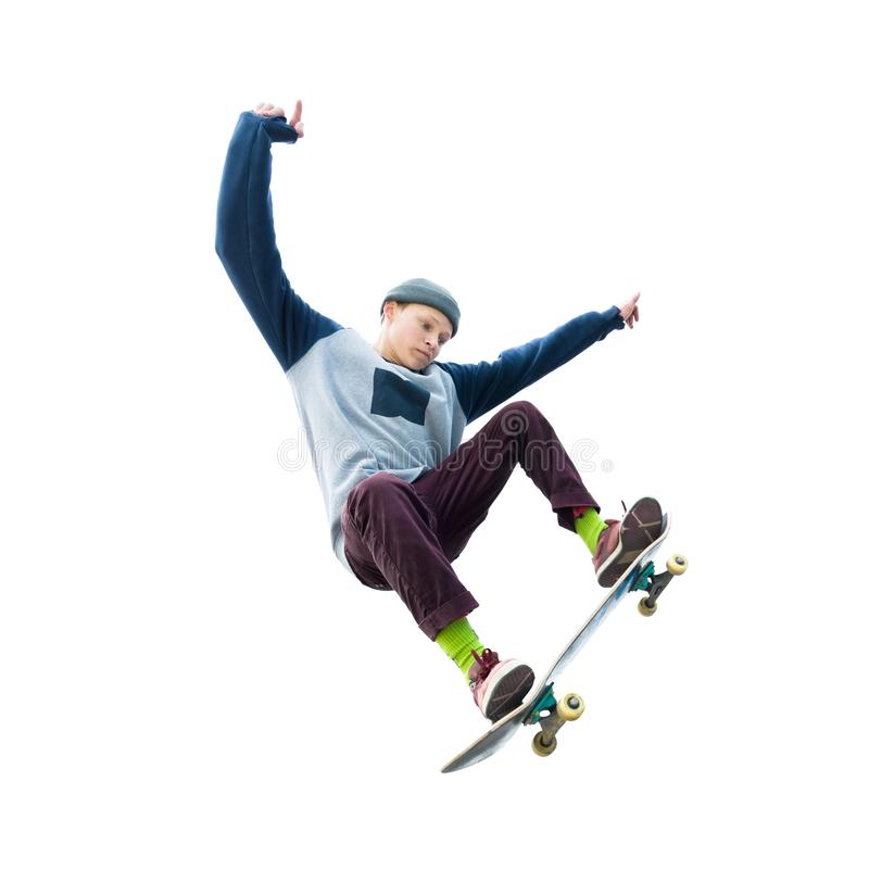 A teenager skateboarder jumps an ollie on an isolated white background. The concept of street sports and urban culture royalty free stock image