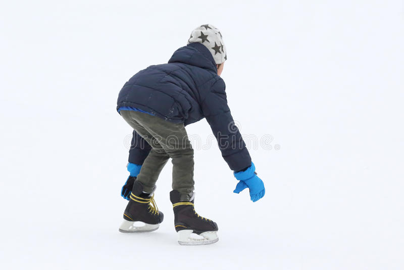 Teenager is skating on the ice rink. The teenager is skating on the ice rink royalty free stock photography