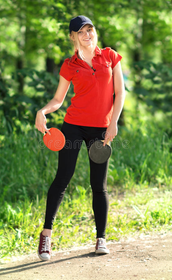 Teenager with a skipping rope in park royalty free stock photography