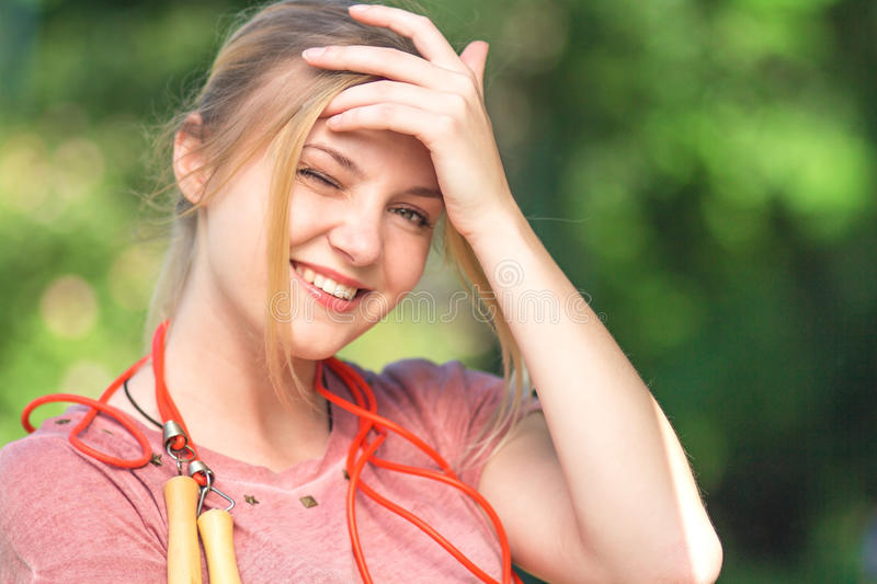 Teenager with a skipping rope in park stock photography