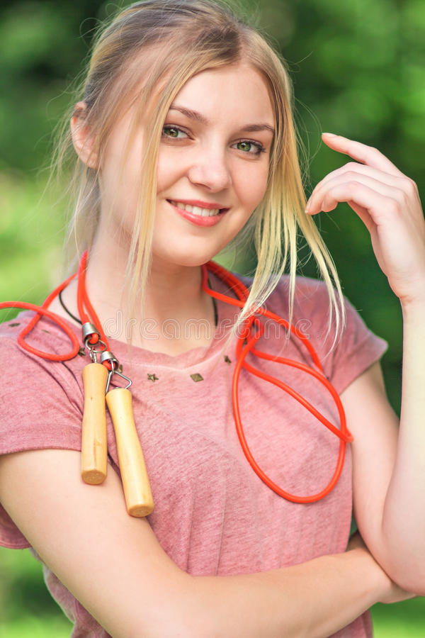 Teenager with a skipping rope in park stock images