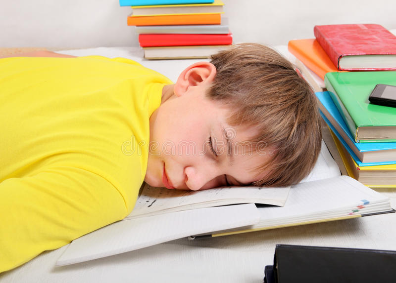 Teenager sleep with a Books royalty free stock photo