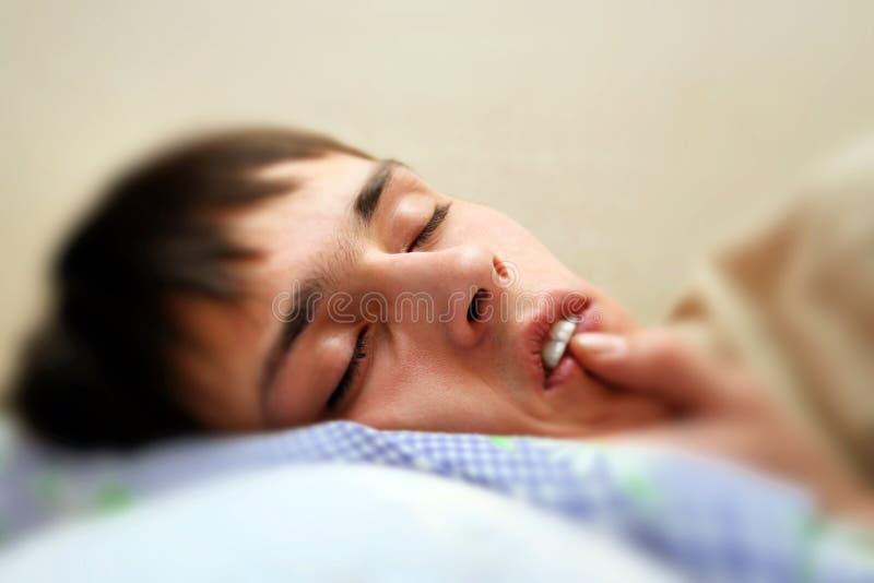 Teenager sleeping royalty free stock photos