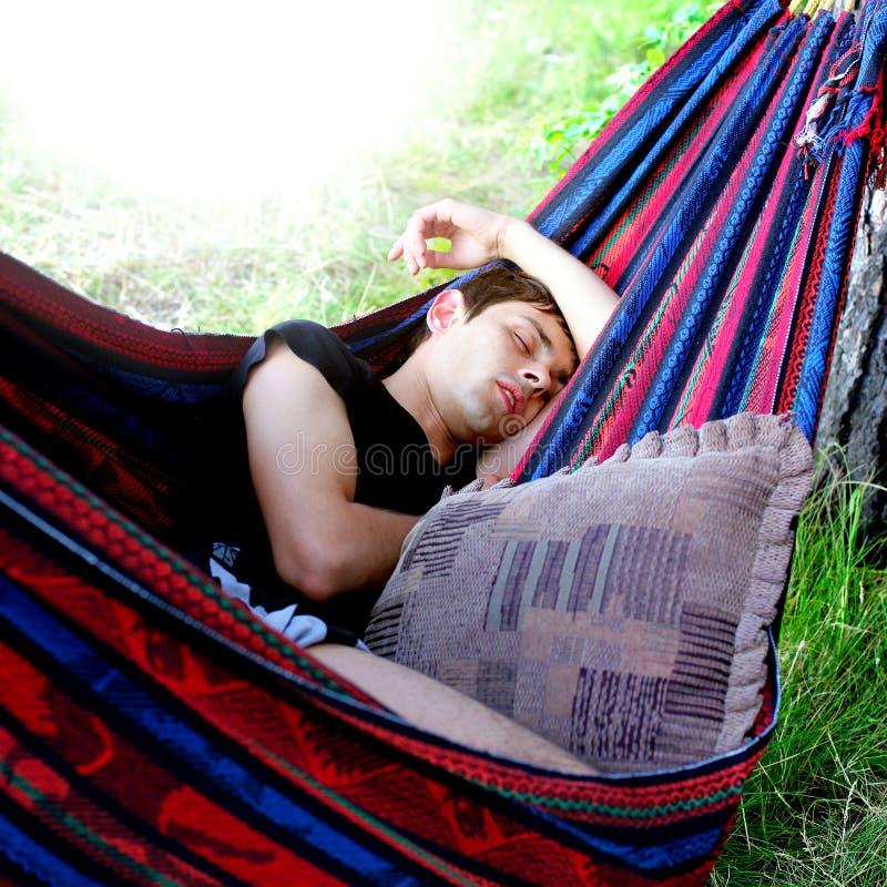 Teenager sleeping in the Hammock stock photos