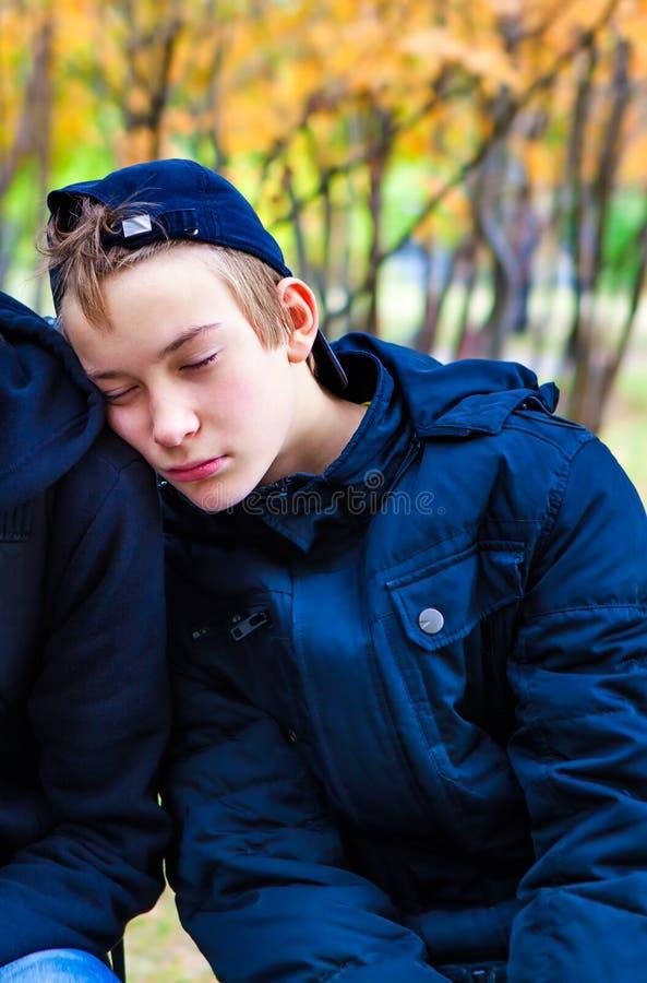 Teenager sleeping outdoor stock photos