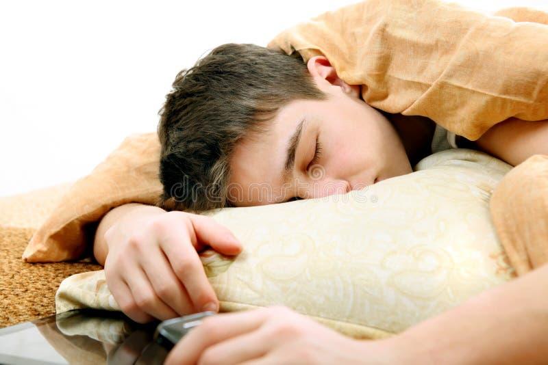 Teenager sleeping stock photography