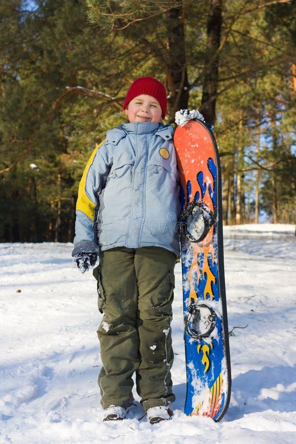 Teenager on snowboard stock photo