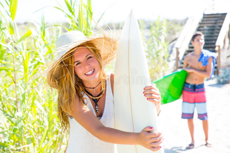Teenager Surfers Waling To The Beach Stock Photos