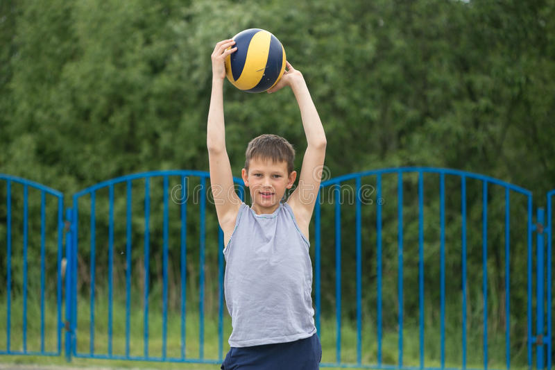 A teenager in a T-shirt and shorts celebrates the victory stock image
