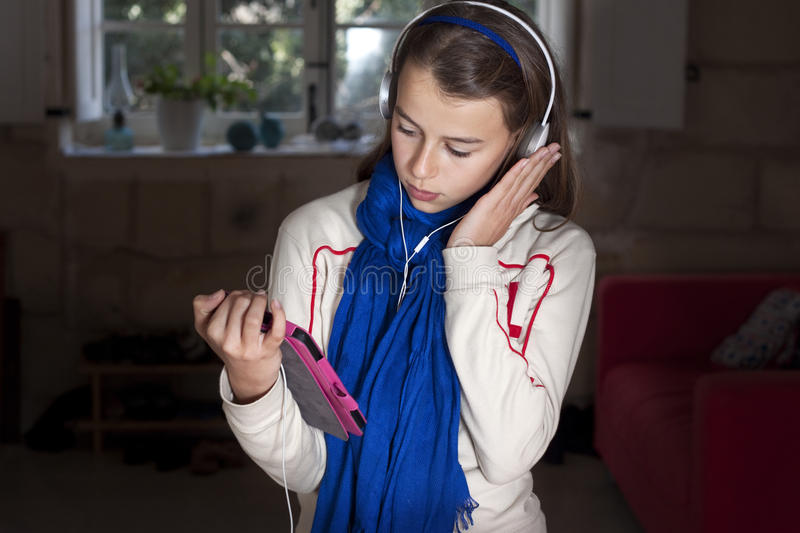 Teenager with tablet stock photos