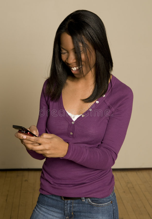 Teenager texting on cellphone royalty free stock photography